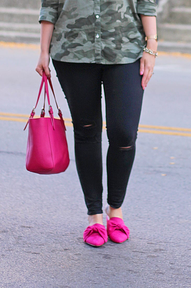 Camo top, black distressed jeans, and hot pink bow mule slides