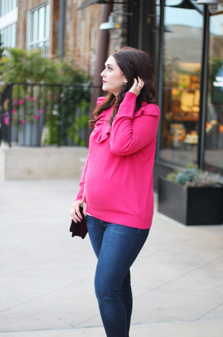 pink ruffled sweater and burgundy velvet heels
