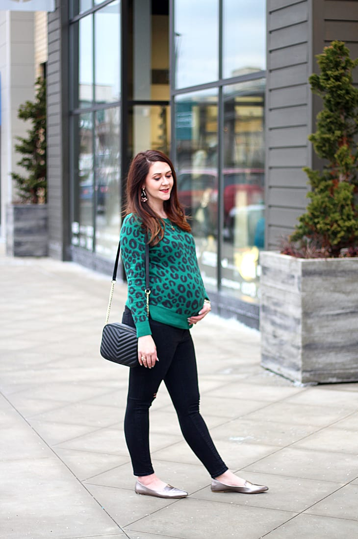Green leopard print sweater and black ripped maternity jeans