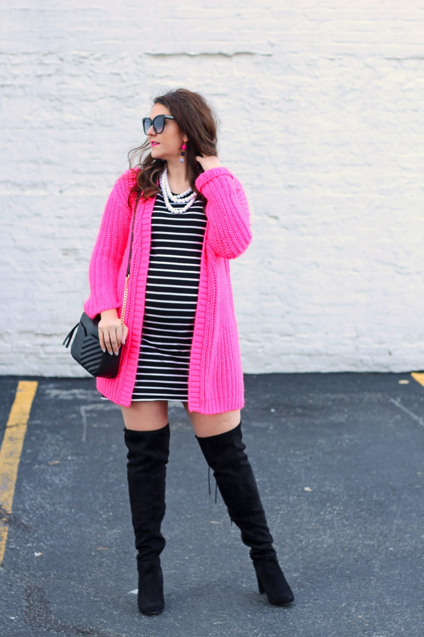 Neon pink cardigan, over the knee boots, and striped maternity dress 1