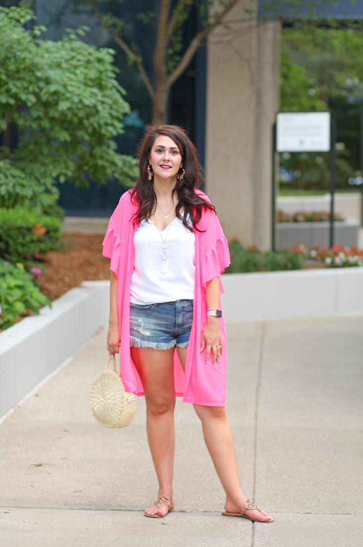 Hot pink kimono and cutoff denim shorts