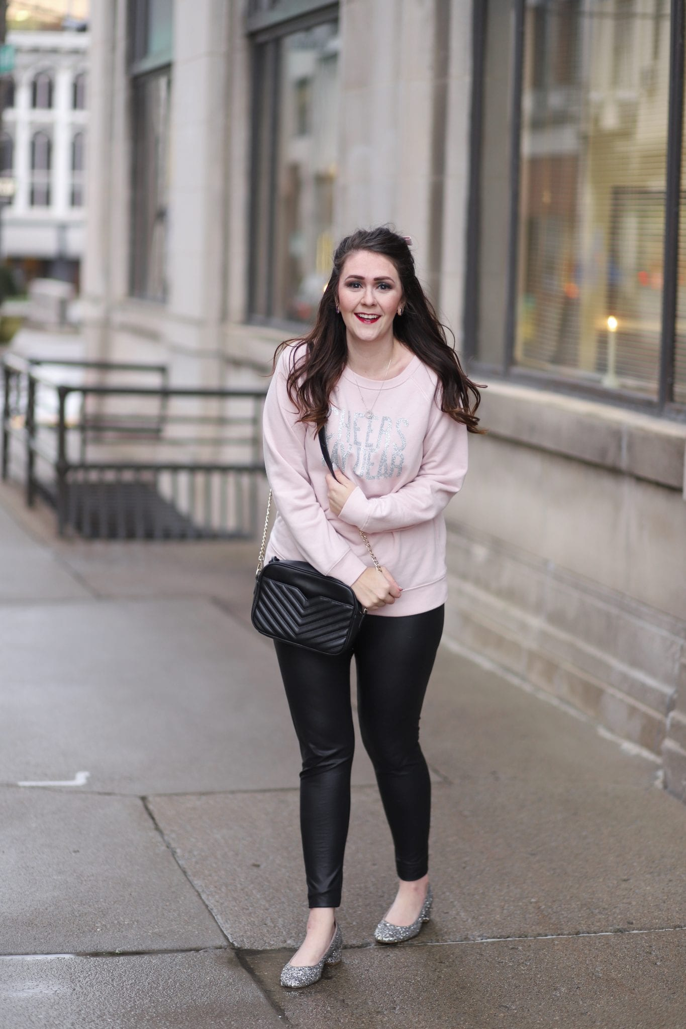 15c23fe2cf8970 Here's my casual but sparkly New Year's Eve outfit. Sweatshirt // Faux  leather leggings ...